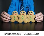 Man Holding Up Gingerbread...