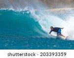 surfing a wave. lombok island.... | Shutterstock . vector #203393359