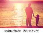 Father And Son  On A Dock At...