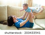 mom rolls baby on your lap... | Shutterstock . vector #203433541