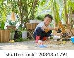 Cute Asian Young Boy Playing...