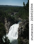 A Large Waterfall Flows From A...