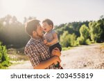 father and son having fun... | Shutterstock . vector #203455819
