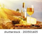 Wine  Grapes And Cheese Agains...