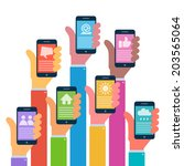 hands with modern smartphones ... | Shutterstock . vector #203565064