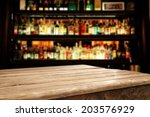 wooden table and bar space  | Shutterstock . vector #203576929