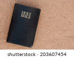 Holy Bible On Sand.