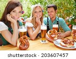 happy friends sitting in beer...   Shutterstock . vector #203607457