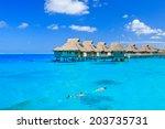 overwater villas in blue... | Shutterstock . vector #203735731