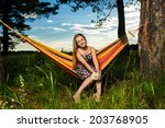 young woman lying in a hammock... | Shutterstock . vector #203768905