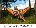 young woman lying in a hammock... | Shutterstock . vector #203768911