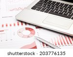 laptop and pen with red... | Shutterstock . vector #203776135