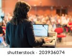 business woman lecturing at... | Shutterstock . vector #203936074