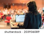 business woman lecturing at...   Shutterstock . vector #203936089