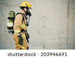 firefighter running with all... | Shutterstock . vector #203946691