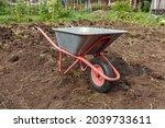 Garden Wheelbarrow Standing In...