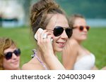 young woman on the mobile phone ... | Shutterstock . vector #204003049