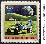 Small photo of Republic of Burundi - CIRCA 1972: Postage stamp 'Lunar rover, Apollo 15' printed in Republic of Burundi. Series: 'Exploration of Space', 1972