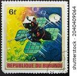 Small photo of Republic of Burundi - CIRCA 1972: Postage stamp 'Lunar Orbiter' printed in Republic of Burundi. Series: 'Exploration of Space', 1972