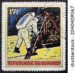 Small photo of Republic of Burundi - CIRCA 1972: Postage stamp 'Apollo 11' printed in Republic of Burundi. Series: 'Exploration of Space', 1972