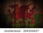 welsh flag over a grunge wooden ...