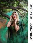 A Blonde In A Green Cloak Of A...