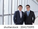 Two Cheerful Asian Business...