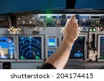 man hand operate switch on... | Shutterstock . vector #204174415
