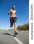 athletic man jogging on open... | Shutterstock . vector #204231094