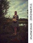 Blonde Girl In A Peasant Dress...