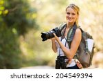 Young Woman Holding A Dslr...
