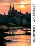 Small photo of Specular surfaces in the Zaryadye park against the Saint Basil's Cathedral at summer sunset