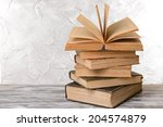 old books on table on grey...   Shutterstock . vector #204574879