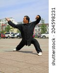 Small photo of LUANNAN COUNTY - JUNE 29: man in black was performing shadowboxing in the square, on june 29, 2014, LuanNan county, hebei province, China