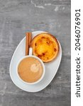 Small photo of typical portuguese dessert pastel de nata with cup of coffee
