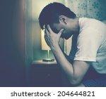 asian man worry and sleepless... | Shutterstock . vector #204644821