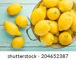 Stock photo fresh lemons in retro colander 204652387