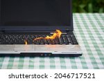 Laptop Burning In Flames On A...
