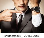 business man pointing at the... | Shutterstock . vector #204682051