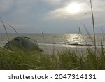 Green Tent On The Shore Of A...