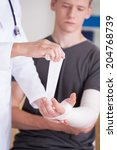 man with broken hand at... | Shutterstock . vector #204768739