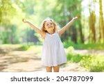 charming little girl enjoying... | Shutterstock . vector #204787099