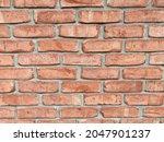 An orange brick wall. Original public domain image from Wikimedia Commons