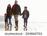 Family Walking Along Winter...