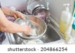 hands to washing disk close up   Shutterstock . vector #204866254