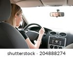 Young Cheerful Woman Driving...