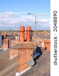 a brick chimney stack with red...