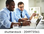 image of two young businessmen... | Shutterstock . vector #204973561
