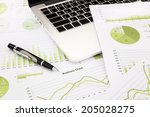 laptop and pen with green... | Shutterstock . vector #205028275