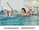 female fitness class doing aqua ... | Shutterstock . vector #205032457